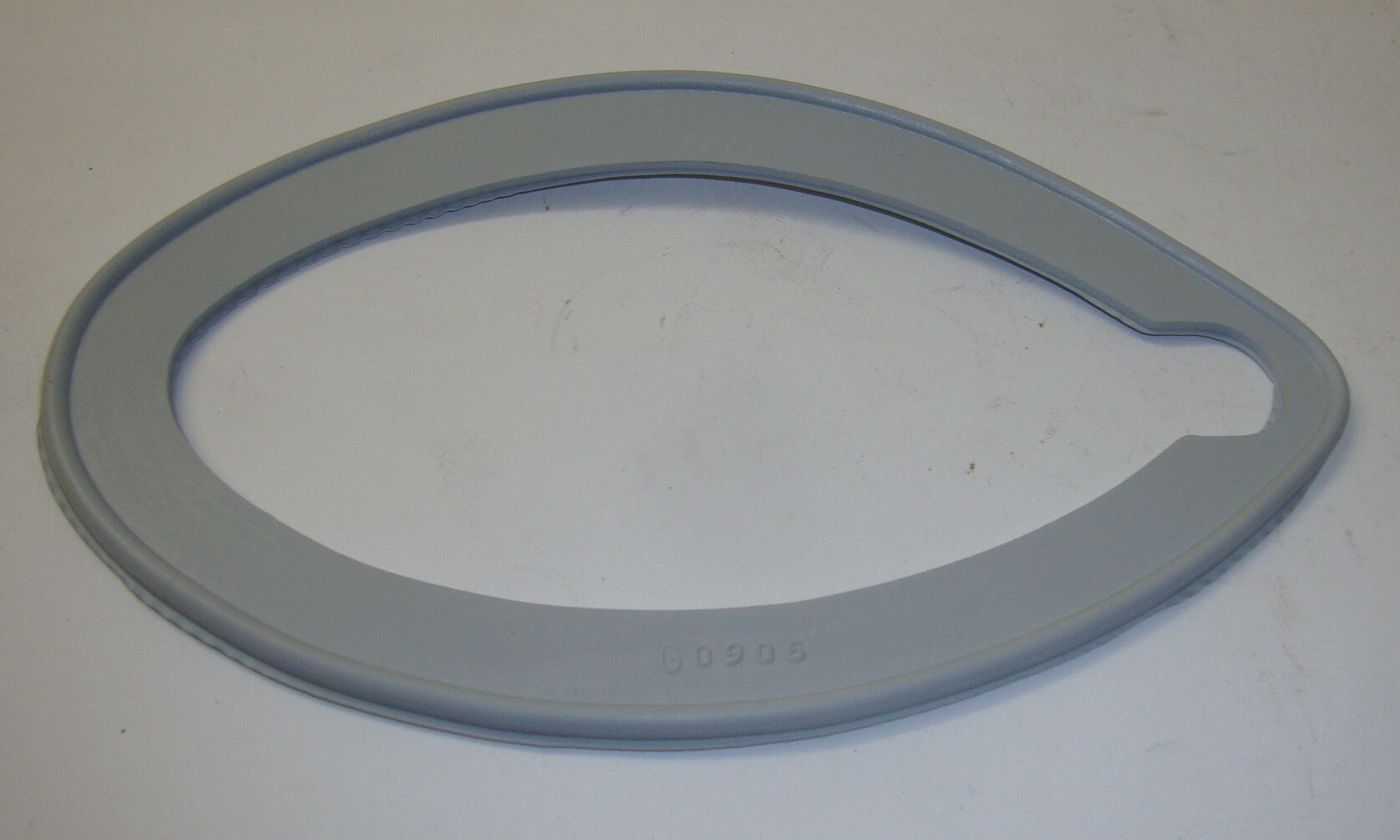 Gasket between headlamp and mudg