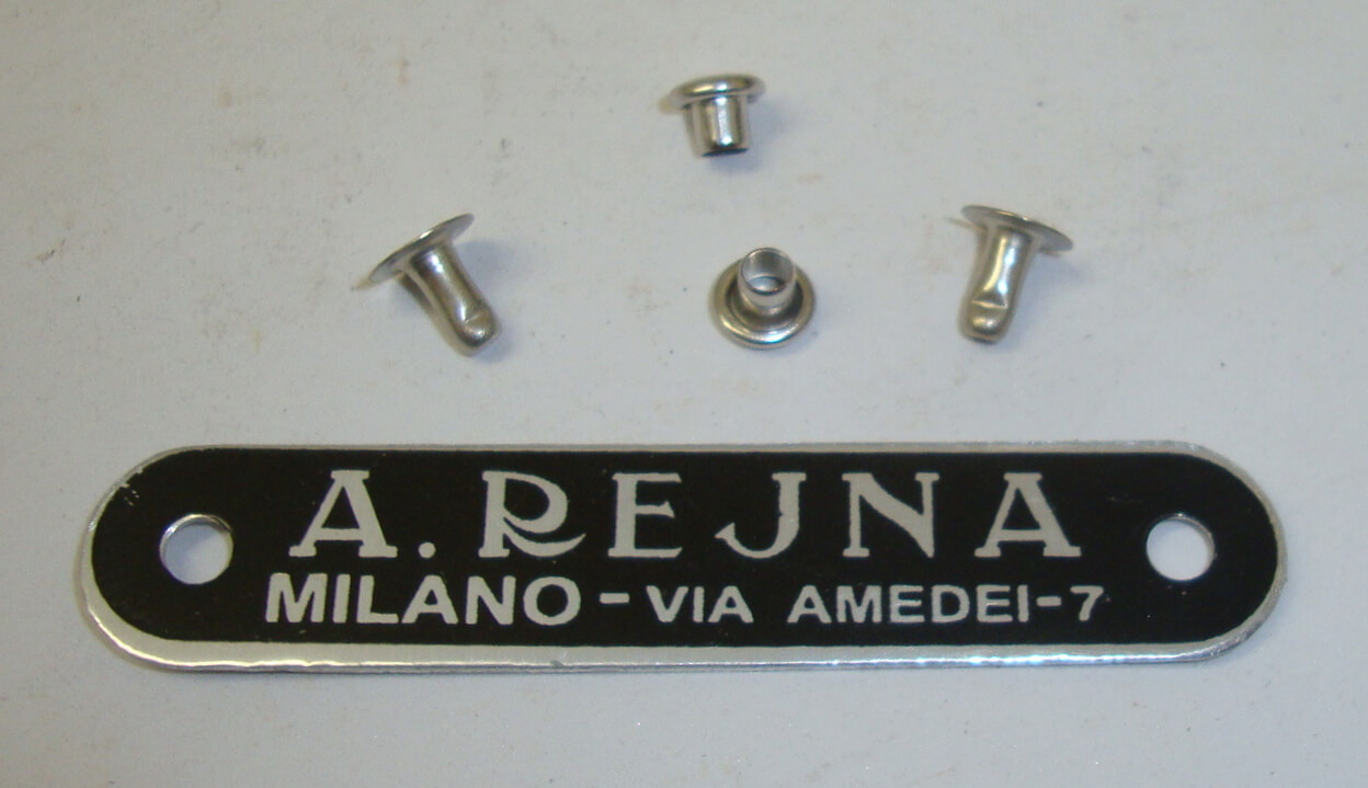 "Plate with rivets, ""A.REJUNA"", black"